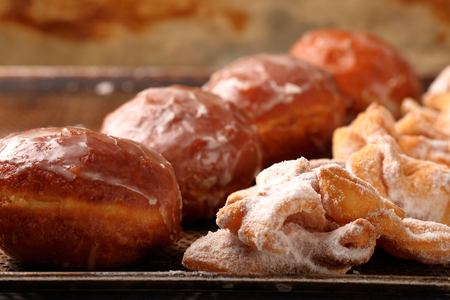Donuts and faworki. Traditional Polish cookies on Fat Thursday and space for text