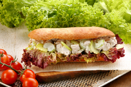 Sandwich with chicken in garlic sauce with cucumber