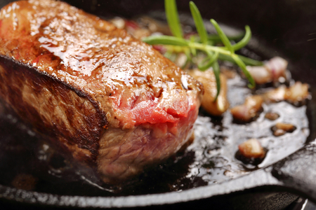 Beef steak on cast iron skillet with empty space for text Stock Photo
