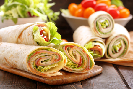 Sandwiches twisted roll tortilla wraps with ham cheese and vegetables Zdjęcie Seryjne - 70772716