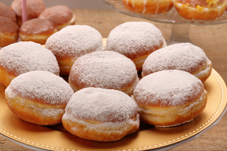 Traditional Polish donuts with liqueur and sugar with empty space for text