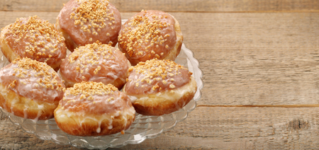Traditional donuts with jam and walnuts with empty space for text