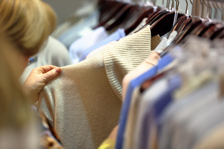 Woman chooses clothes in store