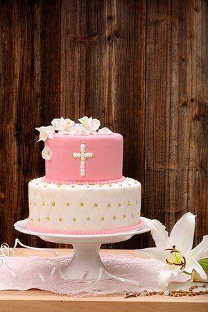 first holy communion cake on wooden background and space for text Stockfoto