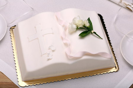 first holy communion cake on the table and space for text Standard-Bild