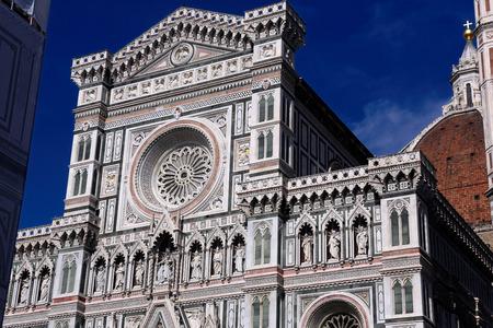 Main facade of Duomo Cathedral Santa Maria del Fiore (Basilica of Saint Mary of the Flower, Duomo di Firenze) in Florence, Italy. East facade.