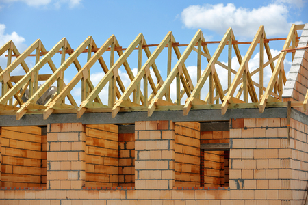 Wooden frame truss system of the roof building.