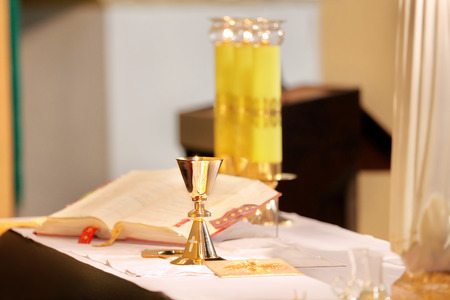 chalices: Golden chalices on the altar during the mass  Stock Photo