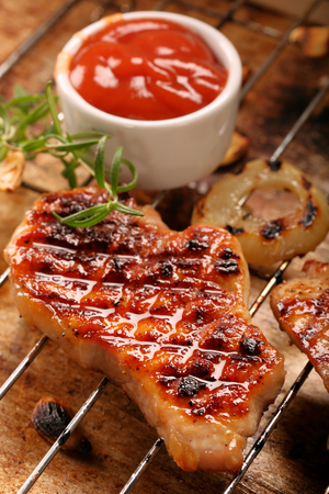 Fried grilled pork with onion on rustic background  Stock Photo