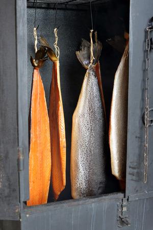 Fresh smoked salmon in smoker grill