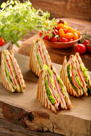 Fresh four sandwiches on wooden background   Zdjęcie Seryjne