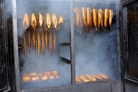 Golden smoked fish in a smokehouse Stock Photo