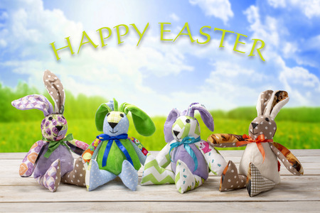 Easter bunnies family with happy easter inscription. Easter holiday concept.