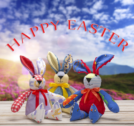 Easter bunnies with happy easter text. Easter holiday concept.