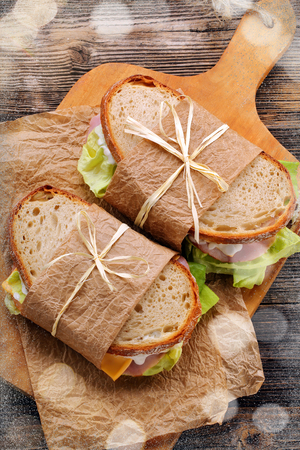 White bread sandwich with ham cheese and lettuce