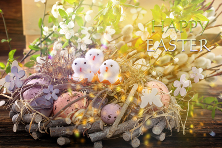 Three Easter chicks with happy easter text. Easter holiday concept.