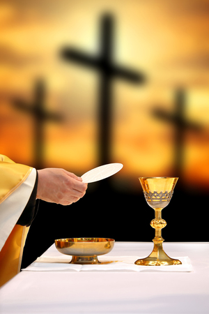 Holy communion on the background of three crosses on top of Golgotha. Easter holiday concept with empty space for text.