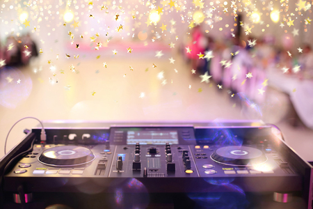 Empty hall during party or wedding celebration with dj mixer and space for text