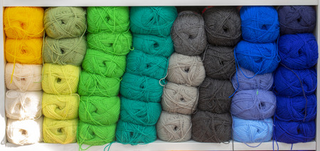 Colorful yarns for sewing on the shelf.  Skeins of yarn concept. 版權商用圖片
