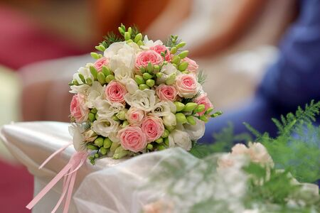 Bride wedding bouquet at church ceremony