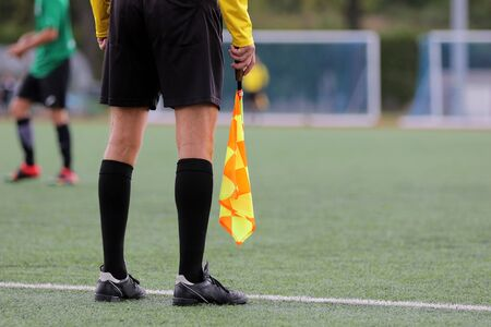 The line referee observes the situation on the football field