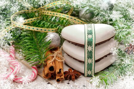 Christmas cookies with decorations on wooden background with space for text