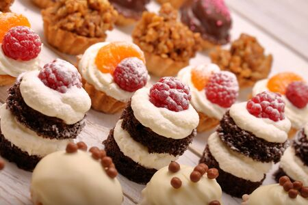 Sweet cookies, closeup of various kinds of cakes on event or wedding reception