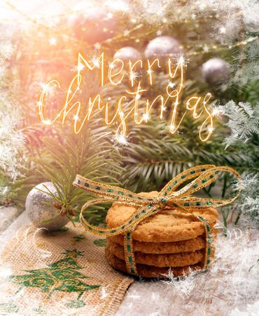 Christmas cookies with decorations on wooden background with merry christmas inscription