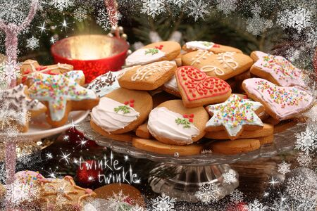 Christmas cookies with decorations on wooden background with twinkle twinkle inscription Stock Photo