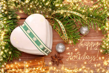 Christmas cookies with decorations on wooden background with happy holidays inscription Stock Photo
