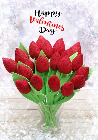 Red artificial roses with Happy Valentines Day inscription Stock Photo
