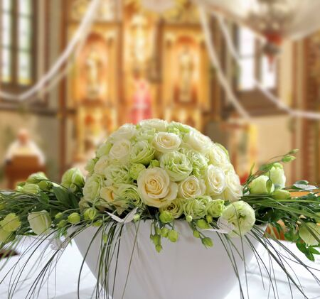 Bouquet of bright yellow flowers in church wedding celebration and empty space for text Stock Photo