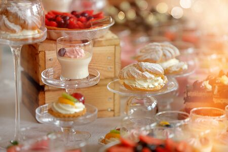 Sweet cookies and desserts, closeup of various kinds of cakes on event or wedding reception and empty space for text Standard-Bild