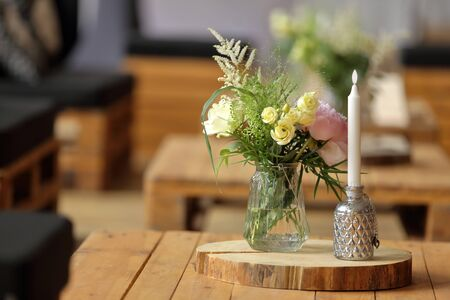 Flower decoration with a candle and empty space for text