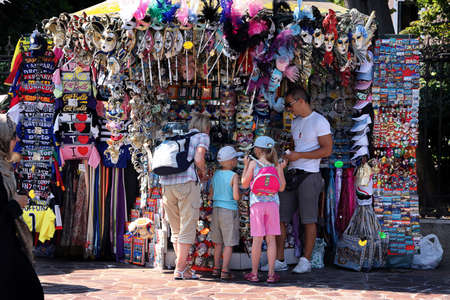 Italy, Venice - 13 June 2019: Souvenir booth in Venice, tourists buy gifts for the family