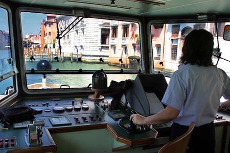 Italy, Venice - 13 June 2019: Vaporetto, vaporetti, water tram in Venice, view from the wheelhouse of the boat