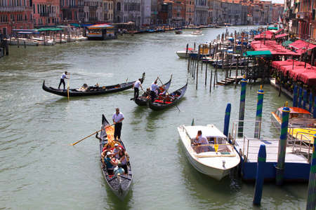 Italy, Venice - 13 June 2019: crowds of tourists in gondolas on the Canal Grande, Venice
