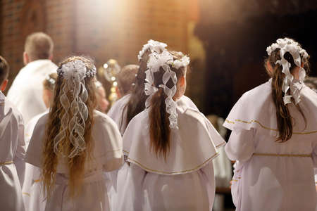 Children going to the first holy communion in the Catholic church