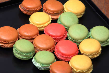 Fresh colorful macaroons taken out of the oven and empty space for text Standard-Bild