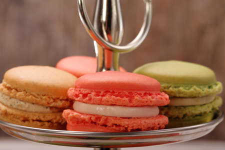 Sweet colorful macaroons on a metal plate and empty space for text Standard-Bild