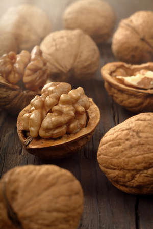 Walnuts in shell on a wooden background and empty space for text
