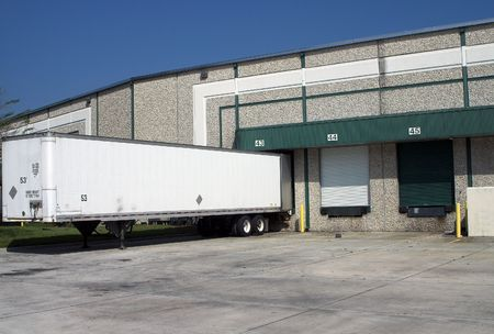 Warehouse building loading bays with empty trailer
