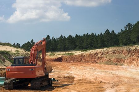 strata: Strata of rock and dirt with heavy equipment on road construction project Stock Photo