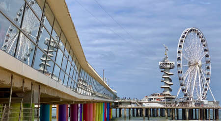 Scheveningen, The Netherlands - July 9 2019 - The Scheveningen Pier is a pleasure pier. It opened in 1959. It has two decks, a bungee jumping facility and a giant Ferris wheel above the sea.