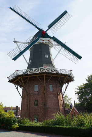 The historic windmill in downtown of Papenburg, Lower Saxony, Germany. It's a smock mill