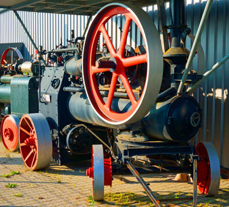 Esens, Germany, Jun 09 2020. A historic steam engine in black and red in the front of a building. The machine has clearly been very carefully restored. Traction engine, road locomotives Editorial
