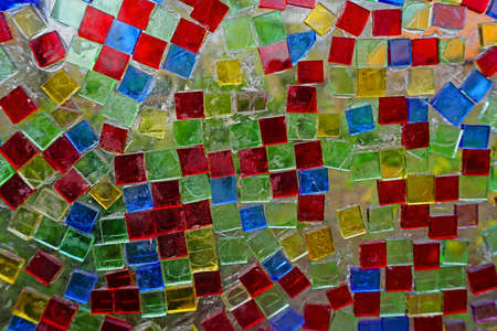 Mosaic with colored glass stones on a glass window