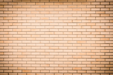 gray texture: Modern vibrant yellow brick wall as a background image with vignette