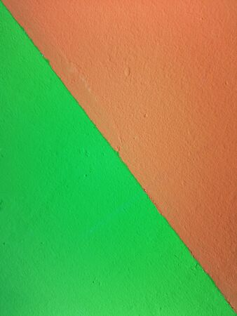 Orange tutti frutti and tweed green wall background texture Archivio Fotografico