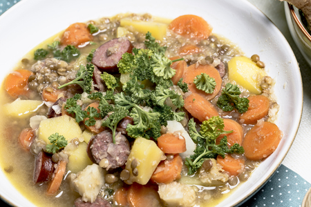 Gemueseeintopf with lentils and Tyrolean smoked sausages